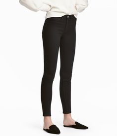 Check this out! Ankle-length jeans in washed stretch denim with a regular waist. Mock front pockets, regular back pockets, and skinny legs. - Visit hm.com to see more.