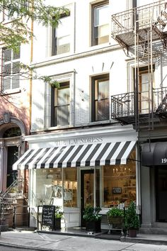 We love seeing Sunbrella being used in storefronts. The Laundress soho uses a Sunbrella awning making this store front windows display simply captivating. Coffee Shop Design, Cafe Design, Store Design, Cafe Exterior, Exterior Design, Cafe Restaurant, Restaurant Design, Laundry Shop, Cafe Shop