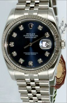 Rolex oyster perpetual datejust, blue face with diamonds. This is my next watch!  Someday....