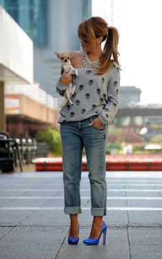 Hair back with off the shoulder sweater cropped jeans and glitter heels