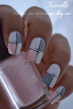 Nice combo of colors. Grey, white, pink and black nails design.