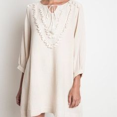 Boho Tunic Dress NWT!!! Look Sexy Chic in this Gorgeous Cream (Eggnog) Tunic Dress! Can also be worn as a blouse with leggings!Material is light and airy which makes for an ultra comfy fit! This dress is lined inside and features 3/4 length sleeves. It has a gorgeous cream color tassel accent on bust area as shown above. Material is Polyester and Cotton. Pair with a pair of heels or cowboy boots and a statement necklace! Measurements: Bust-up to 36 inches Hips- up to 40 inches Length-29…