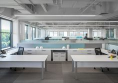 District® is a collection of desks, cabinets, windows and walls that reinterprets systems furniture.