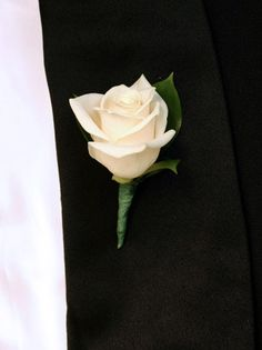 single ivory rose boutonniere. This is what I am trying to do. I will wrap the stem in blue ribbon - but no bows.