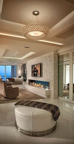 """Modern Living Room with Spark modern fires linear burner system, 72"""", French doors, Exposed beam, Chandelier, stone fireplace"""