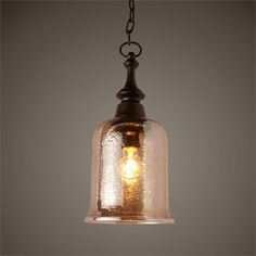 Dark bronze finish and hammered, copper brown luster glass mini pendant. Dimensions: 15h x 7dia. Estimated availability date is May 22. MSRP: $189. Contractor Pricing: $125.