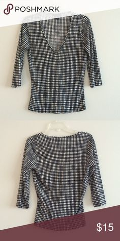 """The Limited silk geo print top 100% silk in excellent condition! 3/4 sleeves and v neck. Not quite a crop top but it has a fitted shape and only 18.5"""" long. So it will be slightly cropped on non-petite size ladies! The Limited Tops Tees - Long Sleeve"""