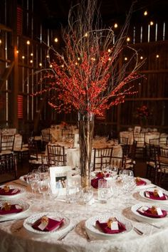 tall-centerpiece-berries-Tracey-David-Riverside-on-the-Potomac-Wedding-Leesburg-Virginia-Kelly-Ewell-Photography, tall berry centerpiece, red centerpiece, red and white reception, red table napkin reception, reception table inspiration, table numbers, barn wedding, rustic wedding