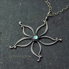 Pretty wire flower creatively woven into a pendant by Strukova Elena - кулон