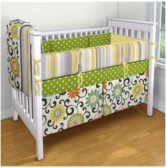 My dream crib bedding.... Green and yellow and orange with flowers...