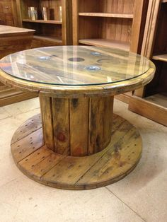 Old cable table with glass top