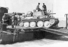 """German light tank of Czech production Panzer from the Panzer Division of the Wehrmacht is unloaded from a self-propelled ferry of the type """"Zibel"""". Date: Source: World War 2 album Panzer Ii, Ww2 Pictures, Ww2 Photos, Tank Destroyer, Armored Fighting Vehicle, Ww2 Tanks, World Of Tanks, German Army, Armored Vehicles"""