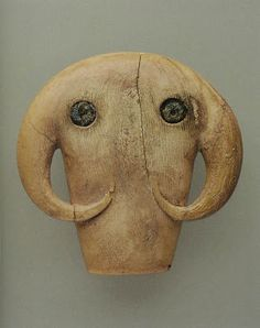 Egyptian amulet in the shape of an elephant's head, ca. 3650-3300 BCE; ivory, blue frit