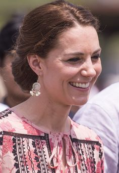 The Duchess of Cambridge wearing a Topshop embroidered smock dress