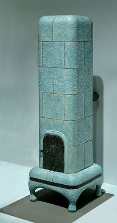 Ceramic tiled stove.  I love the idea of these stoves/fire place.  Imagine the punch of color in a contemporary setting.