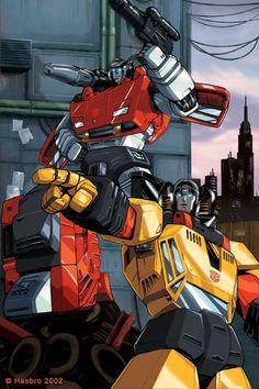 Sunstreaker & Sideswipe. Just two boys having fun! LOL :) Transformers