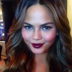 """Another #darklipstick moment this week. Tonight on the gorgeous @ChrissyTeigen , we used #ckonecolor long wear foundation in 600, cream powder blush in """"fun"""", volume mascara in black, lip liner in """"mistress"""", pure color lipstick in """"loud mouth"""""""