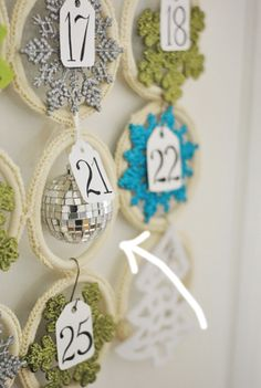advent calendar for ornaments using the scarf holder from IKEA.... PERFECT ....