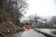 At work: Ullswater Steamers continue the clean-up at Pooley Bridge Pier, Cumbria, in the w...