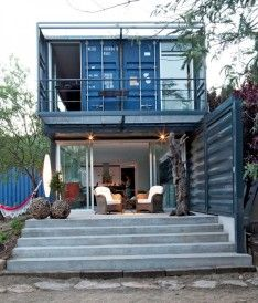 Modern Shipping Container Home In Blue Nuance Designed With Open Terrace And Living Room Background Through Glazed Wall