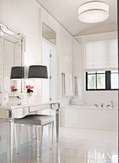 Thassos tile from Waterworks was chosen for the flooring in this bathroom which features a Julia Gray Venetian mirror and a custom vanity.