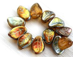 Hey, I found this really awesome Etsy listing at https://www.etsy.com/listing/222965981/topaz-leaf-beads-czech-glass-amber-with