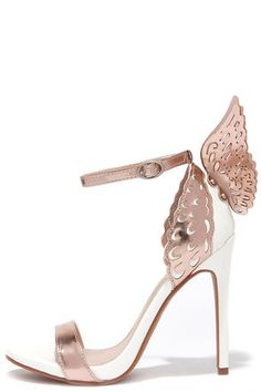 "Well looked what just dropped from the sky: the stunning Ooh You're an Angel White and Rose Gold Winged Heels! These eccentric heels have metallic rose gold accenting a white vegan leather upper, with wing-like embellishments for the true angel-at-heart. Adjustable ankle strap. 4.75"" wrapped stiletto heel. Cushioned insole. Nonskid rubber sole. Available in whole and half sizes. Measurements are for a size 6. All vegan friendly, man made materials."
