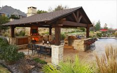 backyard with pool kitchen bar and fence | Outdoor Kitchen Designs With Pool Brown Outdoor Kitchen Designs For ...