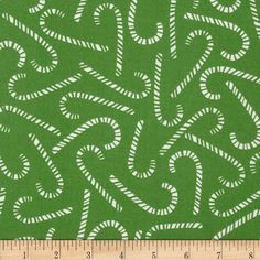 Michael Miller Nordic Holiday Cane Toss Lawn from @fabricdotcom  From Michael Miller Fabrics, this cotton print fabric features white candy canes tossed on a green background.  Fabric is perfect for quilts, home decor accents, craft projects and apparel.