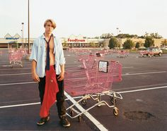 Joel Sternfeld A Young Man Gathering Shopping Carts, Huntington, NY, July 1993 from Stranger Passing Ektacolor print mounted on plexi Edition of 7 with 3 artist's proofs 36 X 45 inches X cm) Fine Art Photography, Street Photography, Portrait Photography, Photography Books, Urban Photography, Joel Sternfeld, Johannes Itten, Dr Marcus, Polaroid