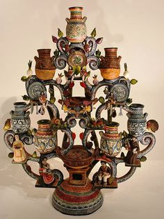 Tree of Life sculpture by Alfonso Castillo depicting the history of mole and Talavera pottery of Puebla. On display at the Museum of Artes Populares in Mexico City.
