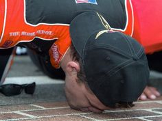 After winning his first of two Cup races at the Brickyard in 2005, Stewart kisses the yard of bricks. The Indiana native also won in 2007.  AJ Mast, Indianapolis Star