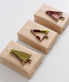 The Best DIY Gift Wrap Ideas Ever - Collect twigs from your back yard and hot glue them together so they form a simple Christmas tree shape. Then decorate with embroidery thread.