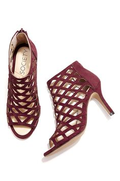 Luxurious suede caged heels with plush foam cushioning for all-day comfort