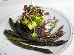 Roasted asparagus with black rice, avocado and radish sprouts