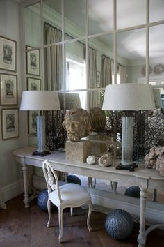 Best way to enlarge and bring more light into a room ~ mirror a wall.