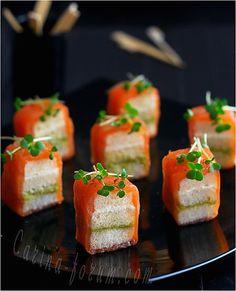 Mini sandwiches with smoked salmon.