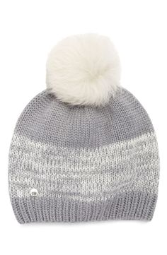 This cozy UGG Australia beanie features a marled-stripe knit and is topped with a genuine shearling pompom.