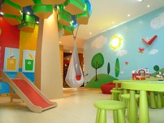 """Decorating Ideas for Fun Playrooms and Kids' Bedrooms : This designer made the most of a large column in the center of the room by turning it into a """"tree."""" A swing hangs from the tree's canopy and a woodsy wall mural keeps the tree company. Design by Leire Sol Garcia de Asch From DIYnetwork.com"""