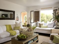 If I had a condo on the beach, this would be my living room. I love white sofas!
