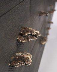 The mushroom-shaped cast-bronze pulls by Gabriella Kiss.