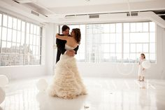 Planned, Designed & Produced by www.swankproductions.com Clean Modern Rooftop Wedding at studio 450. Bride and Groom First Dance #bride #groom #bridal #gown #dress #first #dance #balloons #dance #floor #modern #wedding #rooftop #reception #decor #inspiration #ideas #creative #beautiful clean #white #orange #yellow #studio450