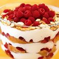 Raspberry, White Chocolate, and Almond Trifle A dream-come-true holiday dessert: so easy to assemble, yet so very impressive (and delicious, too). Köstliche Desserts, Holiday Desserts, Delicious Desserts, Dessert Recipes, Yummy Food, Yummy Recipes, Holiday Recipes, Raspberry Trifle, Raspberry Recipes
