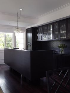 The all black kitchen makes a statement designed by Greg Natale.