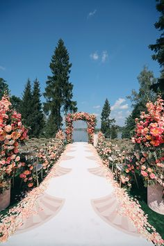 Lovely aisle lined with rose petals.  www.petagarden.com has the most beautiful, biodegradable rose petals you will need for your outside wedding ceremony!