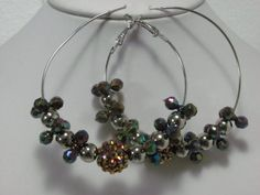 """Basketball wives inspired hoop earrings in brown and silver beads. Large hoops measure 2-1/2"""".  $2.00  Available at www.blingychics.com"""