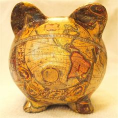 "Old World Map Decoupage Ceramic Piggy Bank - ""Magellan"". $40.00, via Etsy."