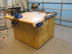 I built this as an outfeed table for my tablesaw, but, added storage and other items for multi-function use.