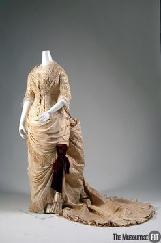 "1883 Worth Evening Dress; The great couturier Charles Frederick Worth was widely regarded as ""an artist of luxury."" He created dresses that were expensive confections of lavish fabrics, trimmings, and embroidery for a clientele of wealthy Europeans and Americans. Worth proclaimed, ""We live by and for luxury."""