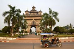 The Patuxai arch where visitors climb five flights for a panoramic view of the city.                                      Credit             David Hagerman for The New York Times Photo by: David Hagerman for The New York Times  NESTLED in a curve of the Mekong River Vientiane Laos  is a place where monks in orange robes outnumber tourists and French  colonial roofs and gilded temples form the skyline. Along the dusty  streets of the capital of Laos youre more likely to spot a polished…